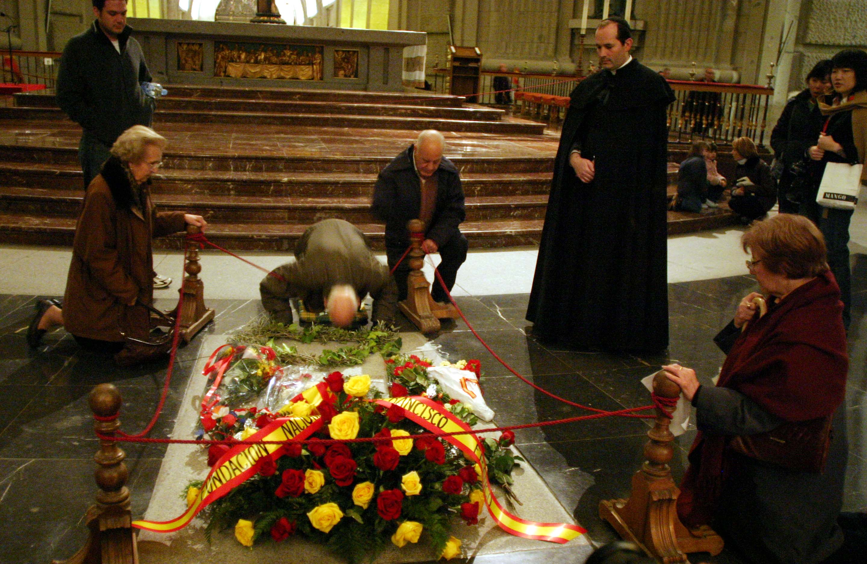 People pay their respects at the tomb of Spain's former dictator Franco in the Valle de los Caidos
